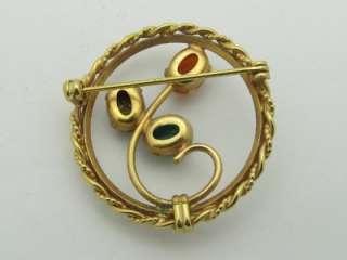 This stunning 1.3 gold toned scarab circle brooch has green, orange