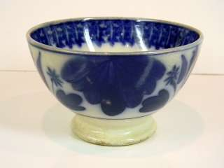 ANTIQUE DUTCH FLOW BLUE FOOTED BOWL BY PETRUS REGOUT