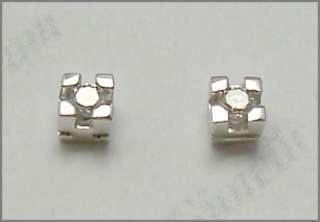 Orecchini oro bianco 18kt. punto luce diamanti 0,16 ct