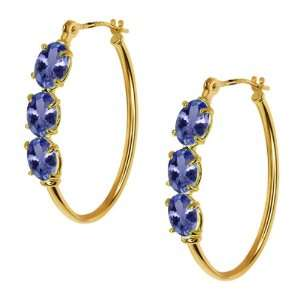 70 Ct Oval Blue Tanzanite 14K Yellow Gold 4 prong Hoop Earrings 6x4mm